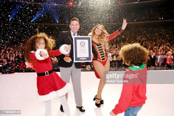 """Mariah Carey is awarded a Guinness World Record by official Guinness adjudicator Michael Empric for """"Highest-charting holiday song on the US Hot 100..."""