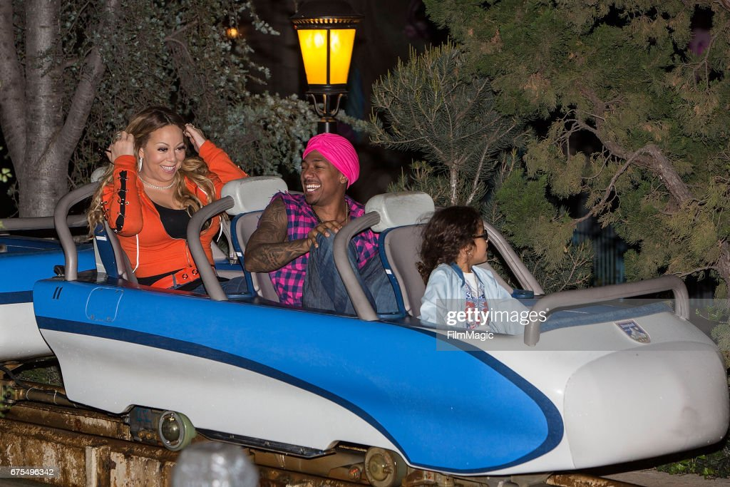 Mariah Carey, Nick Cannon, and Monroe Cannon ride The Matterhorn at Disneyland on April 30, 2017 in Anaheim, California.
