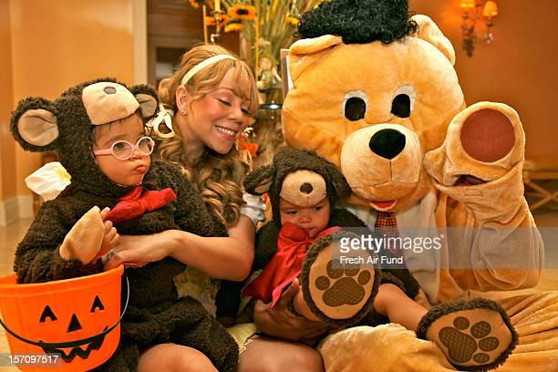 Mariah Carey Nick Cannon Moroccan Cannon and Monroe Cannon have dressed for Halloween as Goldilocks and the Three Bears taken on October 27 2012 as...