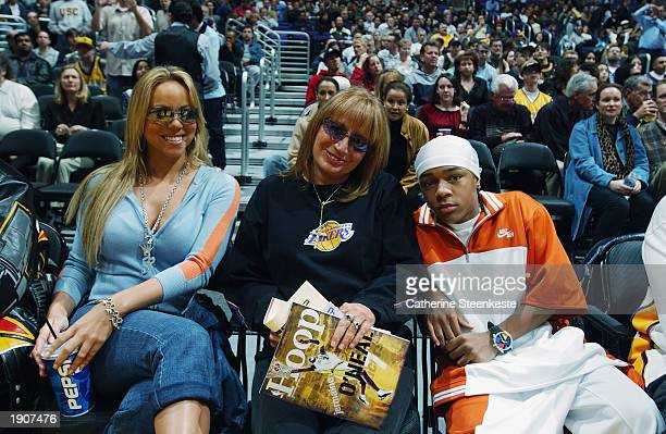 Mariah Carey Penny Marshall Lil Bow Wow pose for a photograph during the NBA game between the Memphis Grizzlies and the Los Angeles Lakers at Staples...