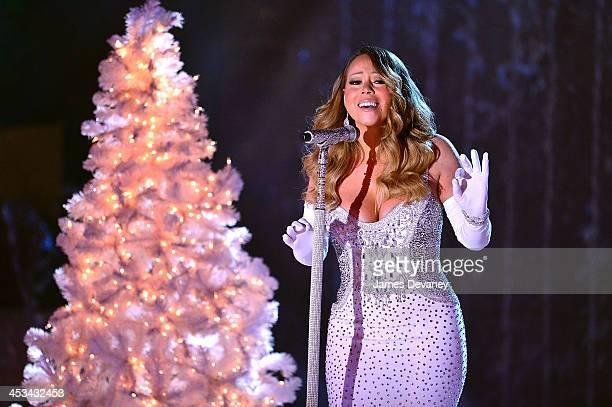 Mariah Carey performs at the 81st Annual Rockefeller Center Christmas Tree Lighting Pre-Tape at Rockefeller Center on December 3, 2013 in New York...