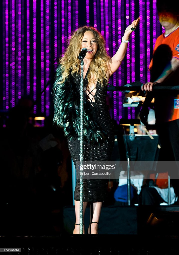 Mariah Carey performs on stage during 2013 Major League Baseball All-Star Charity Concert starring The New York Philharmonic with Special Guest Mariah Carey Benefiting Sandy Relief at Central Park, Great Lawn on July 13, 2013 in New York City.