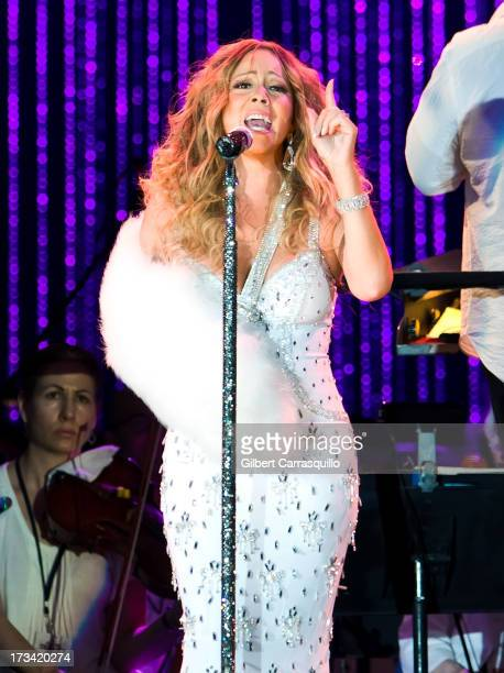 Mariah Carey performs on stage during 2013 Major League Baseball AllStar Charity Concert starring The New York Philharmonic with Special Guest Mariah...