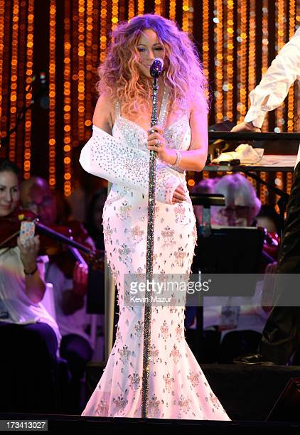 Mariah Carey performs on stage during MLB All Star Charity Concert starring The New York Philharmonic with Special Guest Mariah Carey Benefiting...