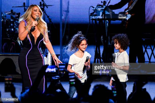 Mariah Carey performs onstage with Monroe Cannon and Moroccan Cannon during the the Caution World Tour at Fox Theater on March 05, 2019 in Atlanta,...