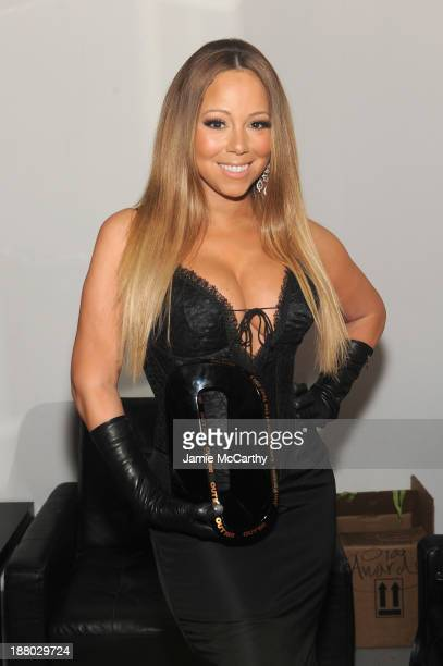 Mariah Carey poses at the 19th Annual Out100 Awards presented by Buick at Terminal 5 on November 14 2013 in New York City