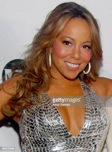Mariah Carey poses for photos inside a New Years Eve celebration at M2 Ultra Lounge on December 31 2009 in New York City