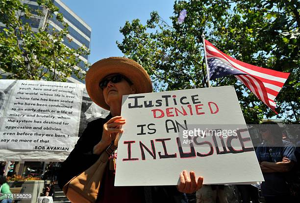 Mariah Healey stands with protesters during a rally in front of the Federal building in Oakland Calif on Saturday July 20 2013 Hundreds of protests...