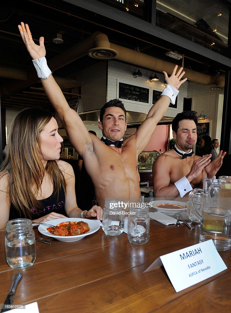 Mariah of the production show 'Fantasy' and Chippendales dancers Jon Howes and Juan DeAngelo appear at the meatball eating contest at the Meatball Spot on March 16, 2013 in Las Vegas, Nevada.