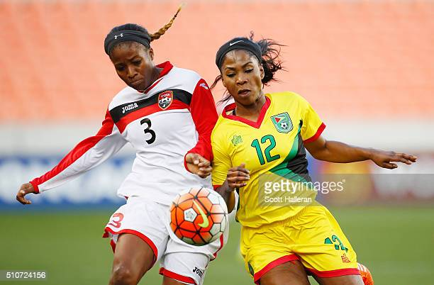 Mariah Shade of Trinidad Tobago battles for the ball against Otesha Charles of Guyana during the 2016 CONCACAF Women's Olympic Qualifying at BBVA...