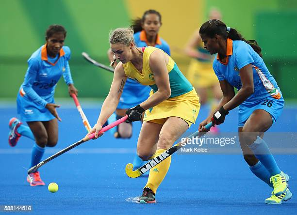 Mariah Williams of Australia is challenged by Sunita Lakra of India during the Women's Pool B Match between India and Australia on Day 5 of the Rio...