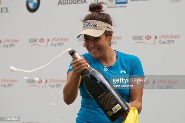Mariajo Uribe of Colombia celebrates the championship title of the HSBC LPGA Brazil Cup at the Itanhanga Golf Club on May 29, 2011 in Rio de Janeiro,...