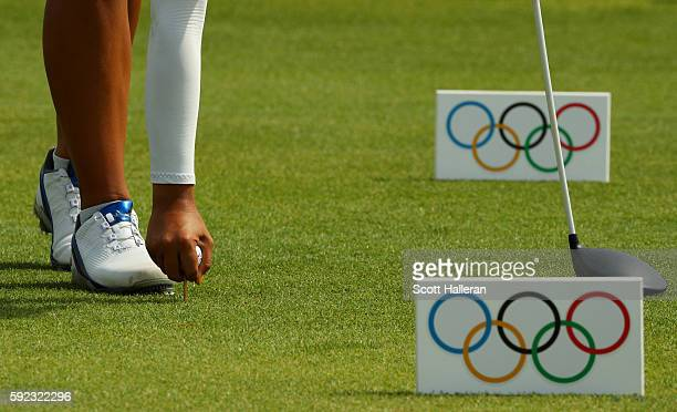 Mariajo Uribe of Colombia tees up her ball on the ninth hole during the Women's Golf Final on Day 15 of the Rio 2016 Olympic Games at the Olympic...