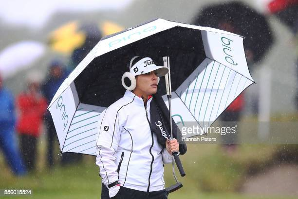 Mariajo Uribe of Columbia waits for an official to discuss the rain on the green during day four of the New Zealand Women's Open at Windross Farm on...