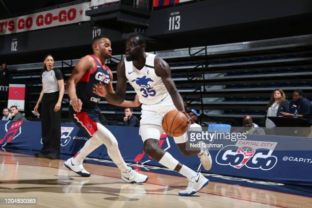 Marial Shayock of the Delaware Blue Coats drives against Phil Booth of the Capital City Go-Go during a NBA G-League game at the Entertainment and...