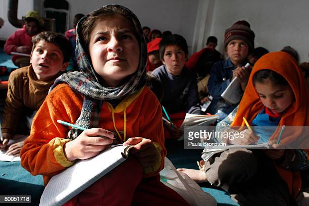 Mariam copies the blackboard during class at the Aschiana school February 28 2008 in Kabul Afghanistan Aschiana schools assist thousands of children...