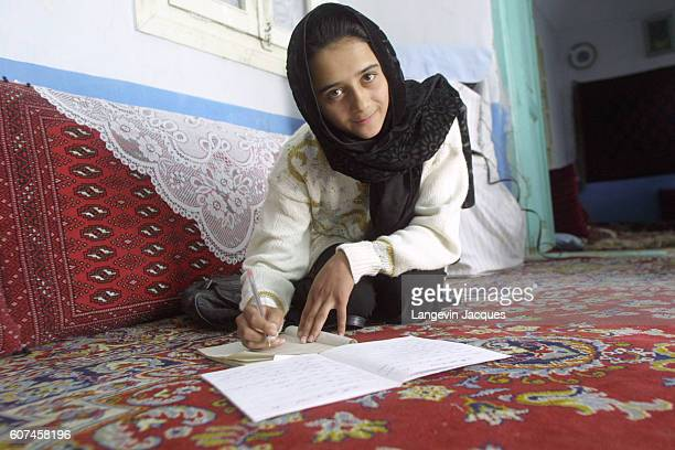 Mariam Mohamadi a 14 yearold Afghani girl in the family home doing her English homework