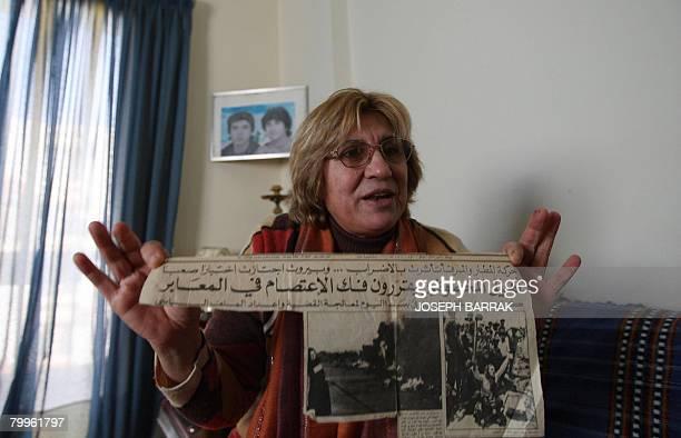 Mariam Saidi holds a newspaper clipping at her apartment in the mainly Shiite Muslim southern Beirut suburbs on February 20, 2008. Mariam spends her...