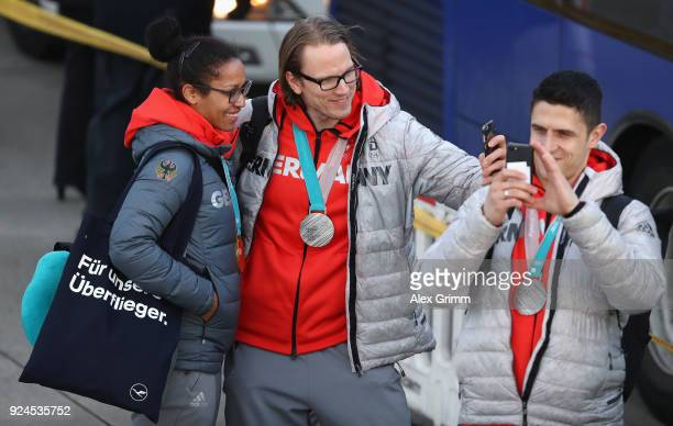 Mariama Jamanka and Christian Ehrhoff take a selfie during the welcome ceremony for the members of Team Germany after their return from the 2018...