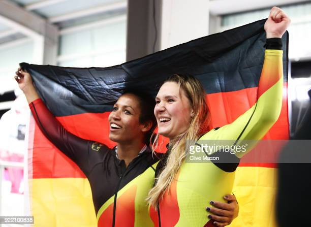 Mariama Jamanka and Lisa Buckwitz of Germany celebrate winning gold in the finish area during the Women's Bobsleigh heats on day twelve of the...