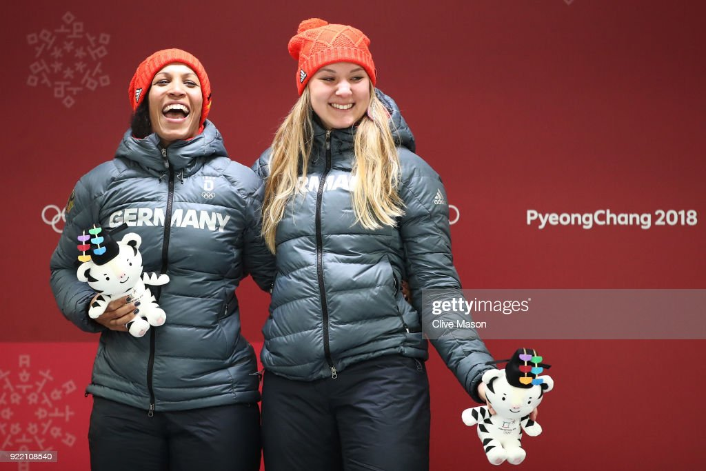 Mariama Jamanka (L) and Lisa Buckwitz of Germany celebrate winning gold during the Women's Bobsleigh heats on day twelve of the PyeongChang 2018 Winter Olympic Games at the Olympic Sliding Centre on February 21, 2018 in Pyeongchang-gun, South Korea.