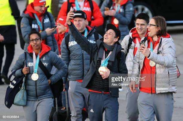 Mariama Jamanka Eric Frenzel and Christian Ehrhoff walk off the Lufthansa plane during the welcome ceremony for the members of Team Germany after...