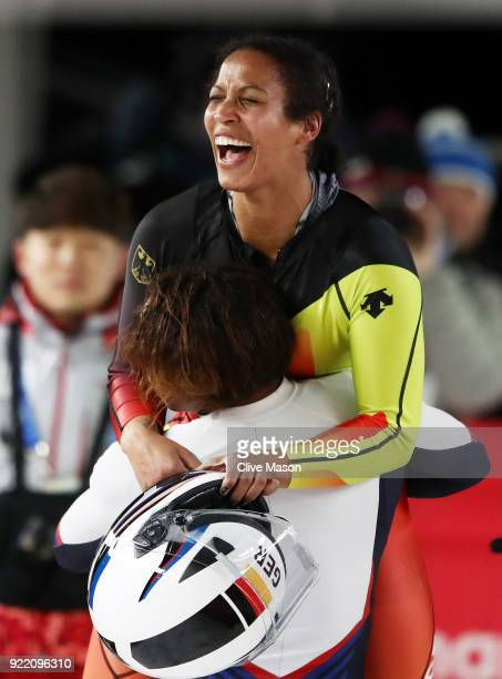 Mariama Jamanka of Germany celebrates with Lauren Gibbs of the United States in the finish area during the Women's Bobsleigh heats on day twelve of...