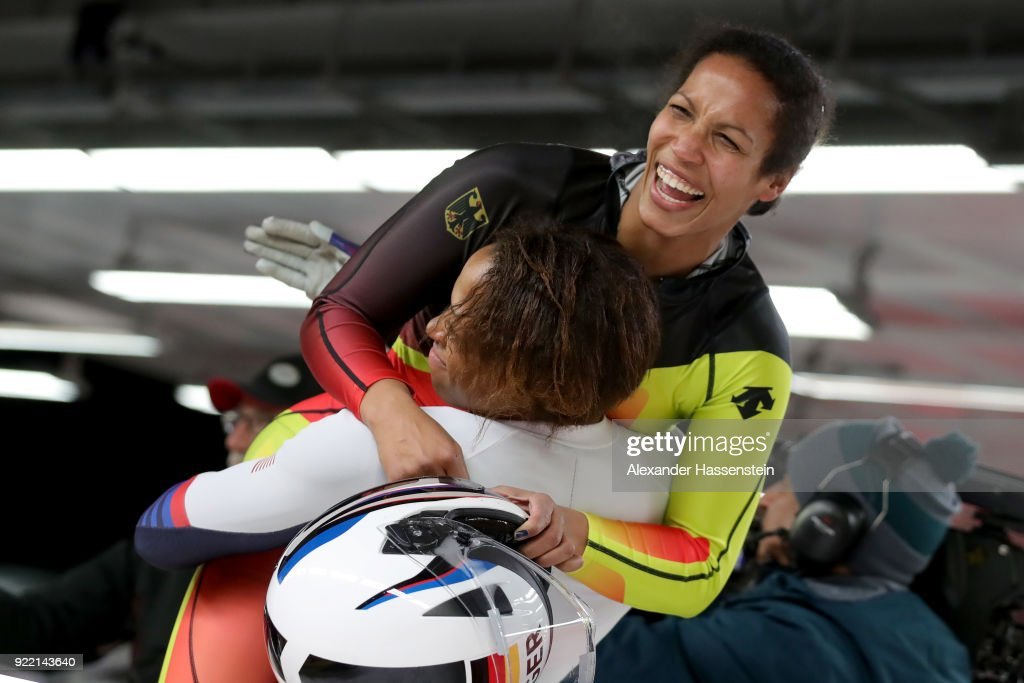 Mariama Jamanka of Germany celebrates with Lauren Gibbs of the United States in the finish area during the Women's Bobsleigh heats on day twelve of the PyeongChang 2018 Winter Olympic Games at the Olympic Sliding Centre on February 21, 2018 in Pyeongchang-gun, South Korea.