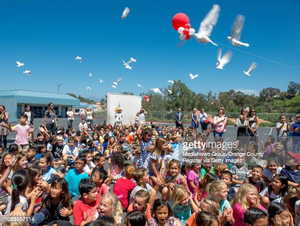 Marian Bergeson Elementary students react as doves are released as part of the 90th birthday celebration activities for the school's namesake, Marian...