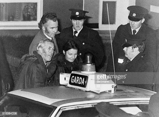 Marian Coyle is escorted to awaiting police car after she and Eddie Gallagher surrendered and released Dr Tiede Herrema who has been held hostage by...