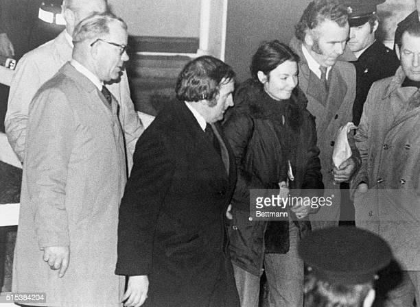Marian Coyle smiles as she is escorted to police car 11/7 after she and Eddie Gallagher surrendered and released Dr Tiede Harrema who they have been...