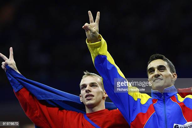 Marian Dragulescu of Romania celebrates with Flavius Koczi of Romania after they came first and second in the vault event during the Apparatus Finals...