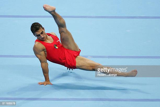 Marian Dragulescu of Romania competes in the floor exercises at the men's artistic gymnastics competition on August 14 2004 during the Athens 2004...