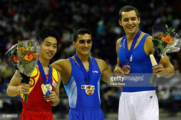 Marian Dragulescu of Romania poses with his gold medal after he won the floor exercise event during the Apparatus Finals on the fifth day of the...
