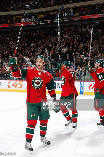 Marian Gaborik Branko Radivojevic and Martin Skoula of the Minnesota Wild celebrate after defeating the New York Islanders at Xcel Energy Center on...
