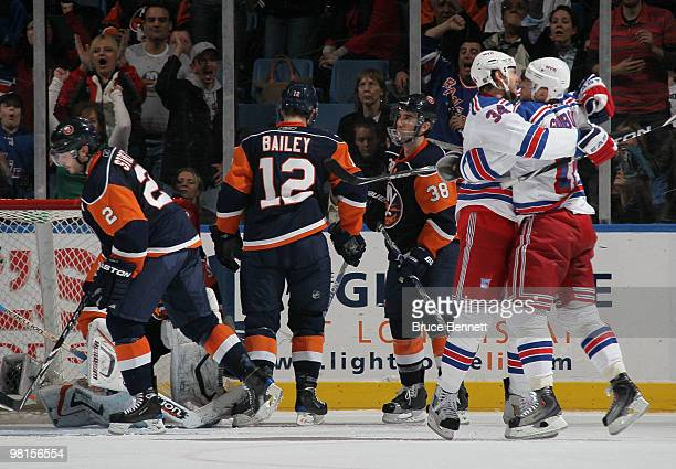 Marian Gaborik is hugged by Aaron Voros of the New York Rangers following his second period goal against the New York Islanders at the Nassau...