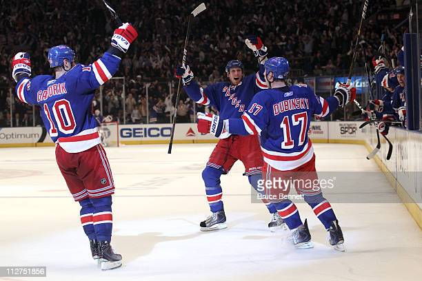 Marian Gaborik Marc Staal and Brandon Dubinsky of the New York Rangers celebrate after Dubinsky scored a second period goal against the Washington...