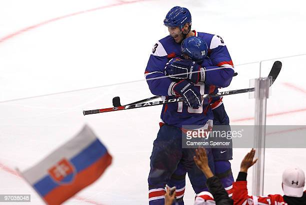 Marian Gaborik of Slovakia celebrates with Zdenko Chara after scoring a second period goal during the ice hockey men's quarter final game between...