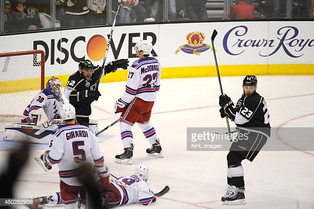 Marian Gaborik of the Los Angeles Kings and Dustin Brown of the Los Angeles Kings celebrate after watching the puck go through the net for the...