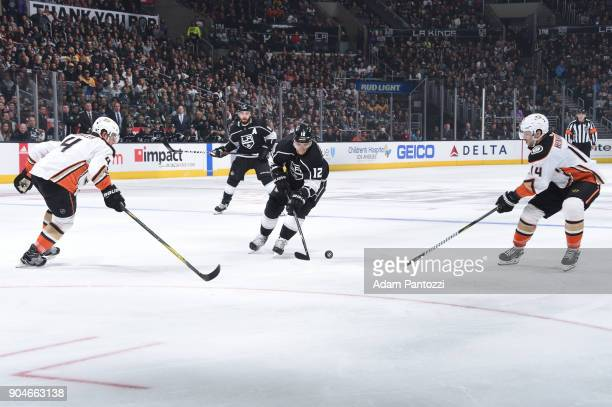 Marian Gaborik of the Los Angeles Kings battles for the puck against Adam Henrique and Cam Fowler of the Anaheim Ducks at STAPLES Center on January...