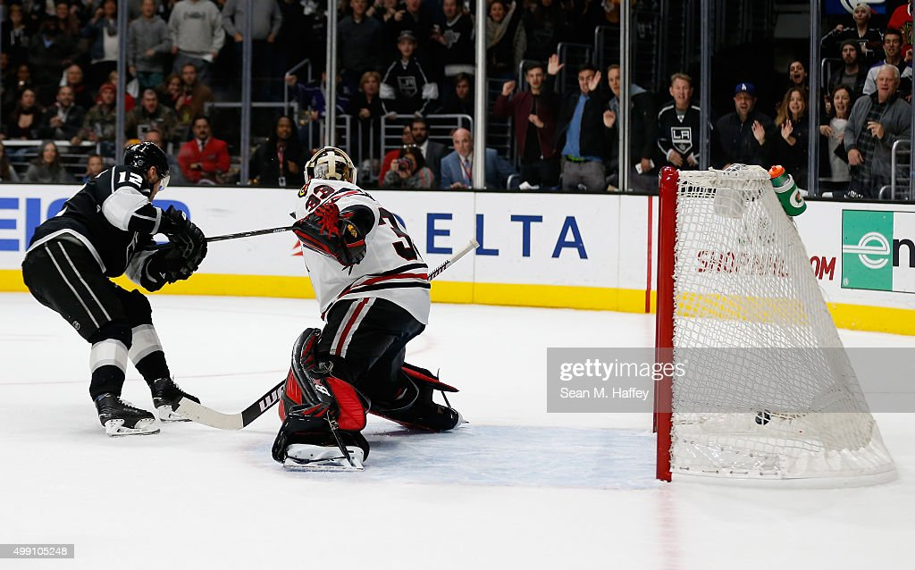 Marian Gaborik #12 of the Los Angeles Kings beats Scott Darling #33 of the Chicago Blackhawks in overtime. The Los Angeles Kings beat the Chicago Blackhawks 3-2 at Staples Center on November 28, 2015 in Los Angeles, California.