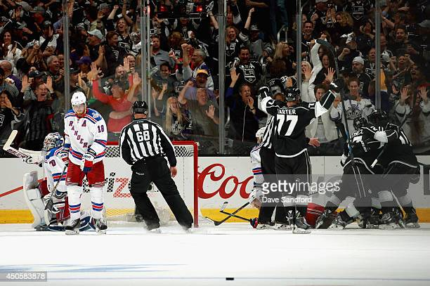 Marian Gaborik of the Los Angeles Kings celebartes his power play goal with teammates and goaltender Henrik Lundqvist and Brad Richards of the New...