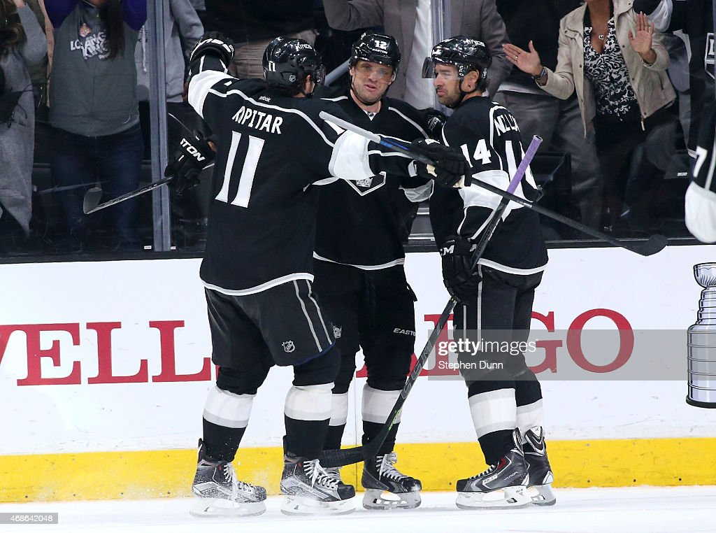 Marian Gaborik #12 (C) of the Los Angeles Kings celebrates with Anze Kopitar #11 an dJustin Williams #14 after his third period goal gave the Kings a 3-1 lead over the Colorado Avalanche at Staples Center on April 4, 2015 in Los Angeles, California. The Kings won 3-1.