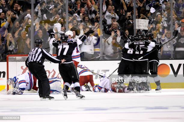 Marian Gaborik of the Los Angeles Kings celebrates with his teammates after scoring a goal against Henrik Lundqvist of the New York Rangers in the...