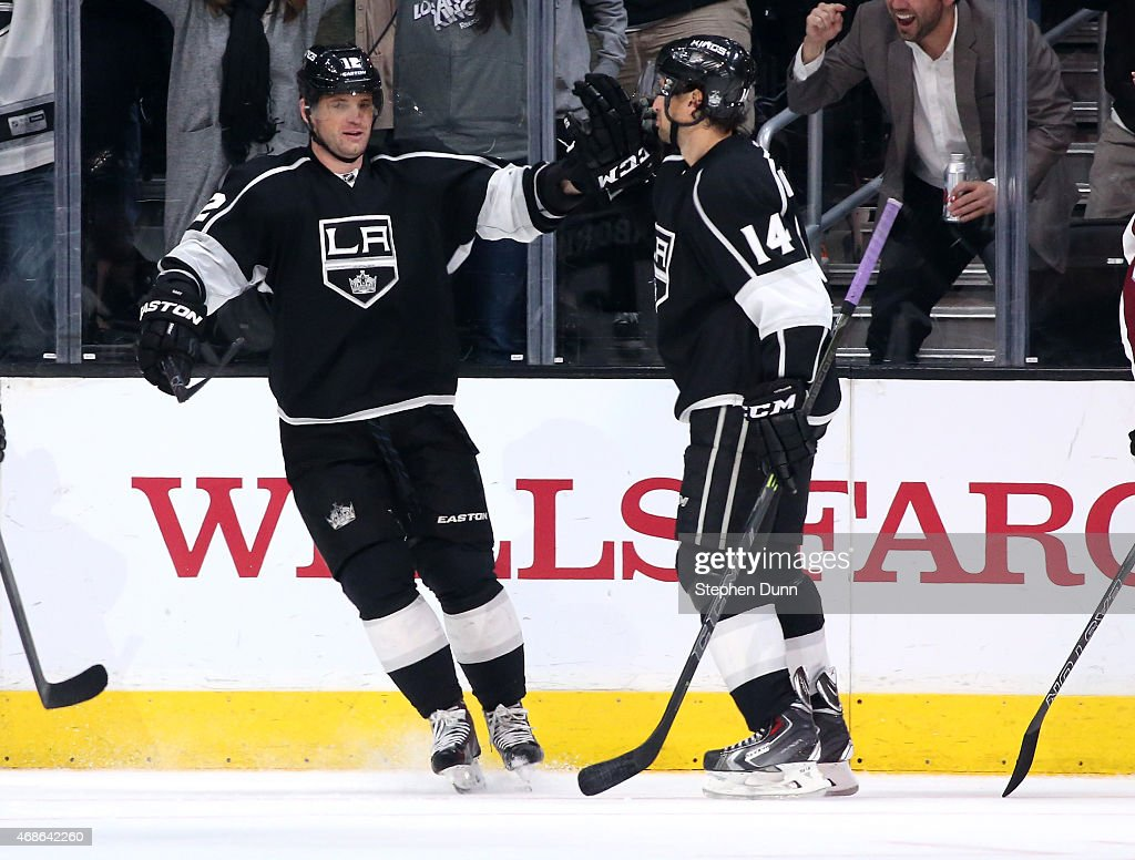 Marian Gaborik #12 (C) of the Los Angeles Kings celebrates with Justin Williams #14 after his third period goal gave the Kings a 3-1 lead over the Colorado Avalanche at Staples Center on April 4, 2015 in Los Angeles, California. The Kings won 3-1.