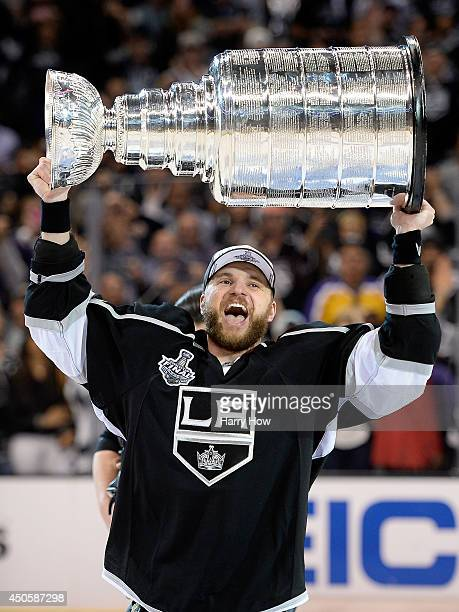 Marian Gaborik of the Los Angeles Kings hoists the Stanley Cup in celebration after defeating the New York Rangers 32 in double overtime of Game Five...