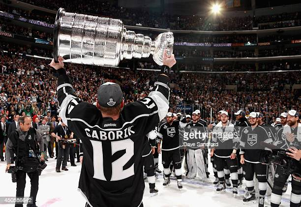 Marian Gaborik of the Los Angeles Kings lifts the Stanley Cup after his team won Game Five with the score of 32 in double overtime over the New York...