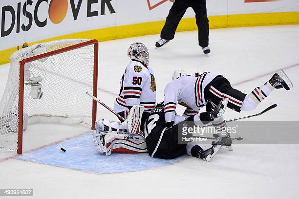 Marian Gaborik of the Los Angeles Kings scores a first period goal past goaltender Corey Crawford of the Chicago Blackhawks in Game Four of the...