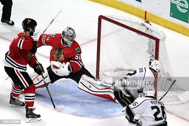 Marian Gaborik of the Los Angeles Kings scores the gametying goal against Corey Crawford of the Chicago Blackhawks in the third period during Game...
