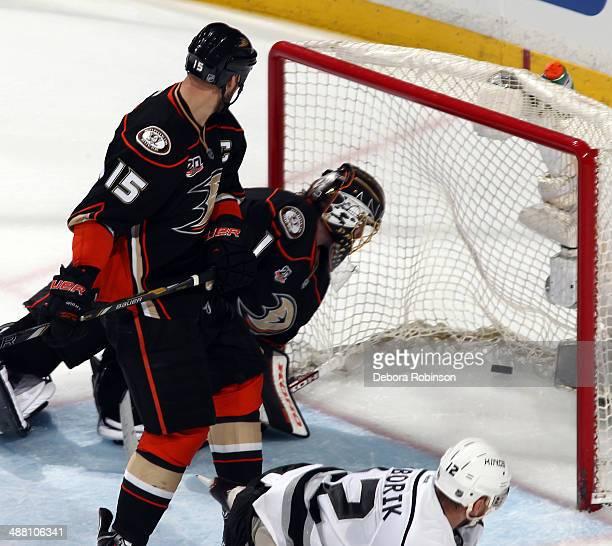 Marian Gaborik of the Los Angeles Kings scores the game-winning goal in overtime as Anaheim Ducks goalie Jonas Hiller and Ryan Getzlaf look on in...